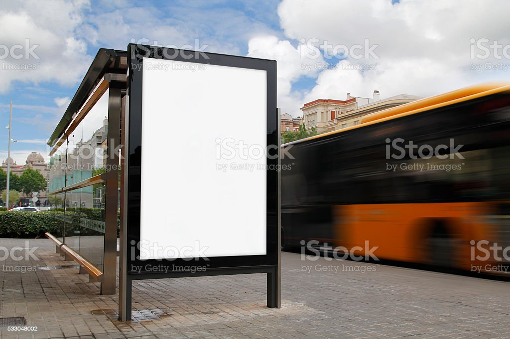 Bus stop with blank billboard stock photo