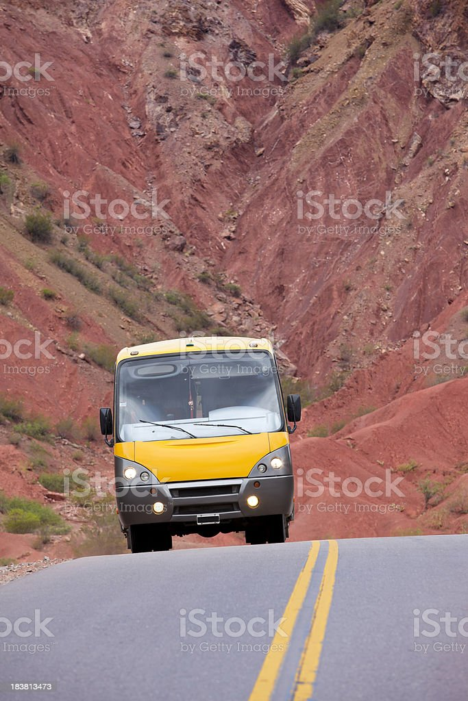 Bus travelling on highway through wilderness of Argentina stock photo