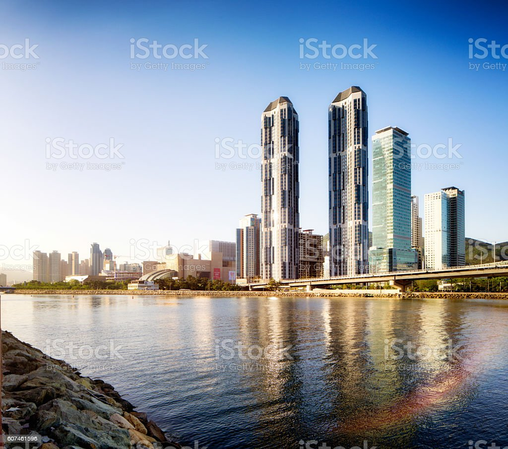 Busan Centum City skyline at sunset with river reflections stock photo