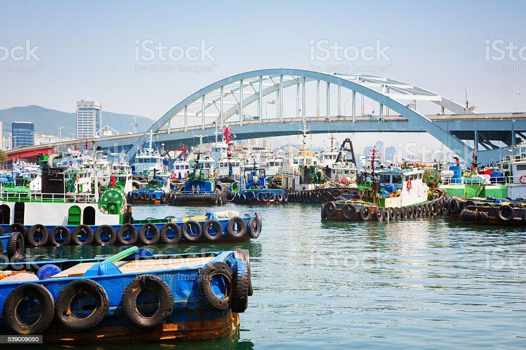 Busandaegyo Bridge with fishing boats in Busan South Korea stock photo