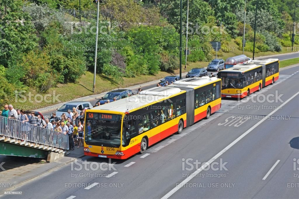 Buses and crowd of people on the bus stop stock photo