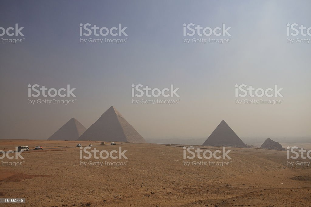 Buses approaching Great Pyramids at Giza stock photo