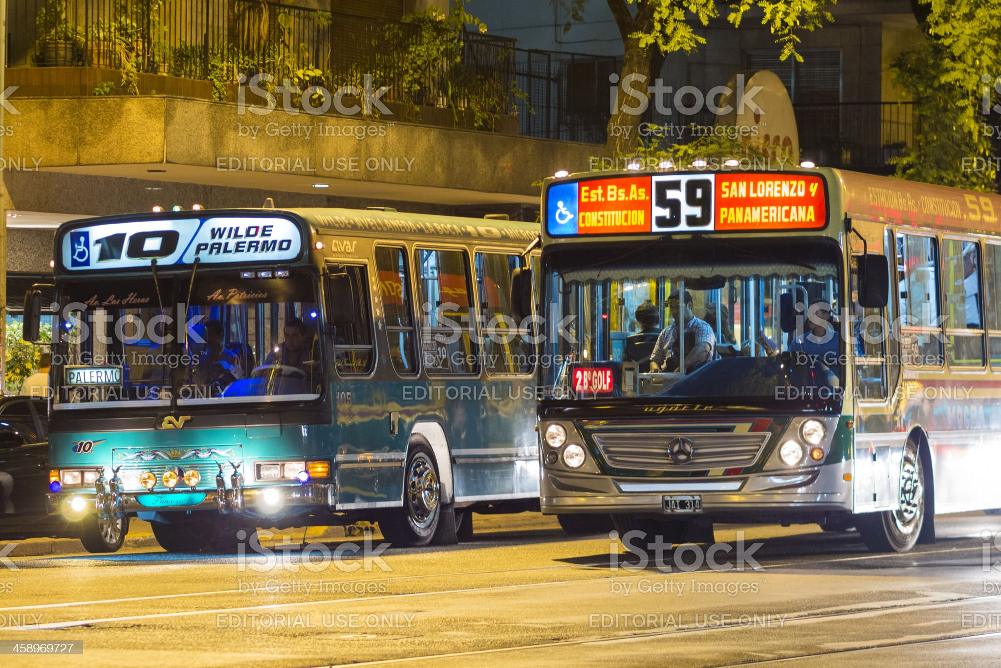 Buses at a Traffic Light- Night, Buenos Aires, Argentina royalty-free stock photo