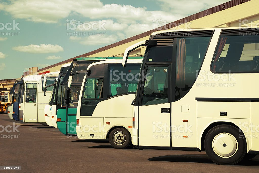 buses at the bus station with cloudy sky stock photo