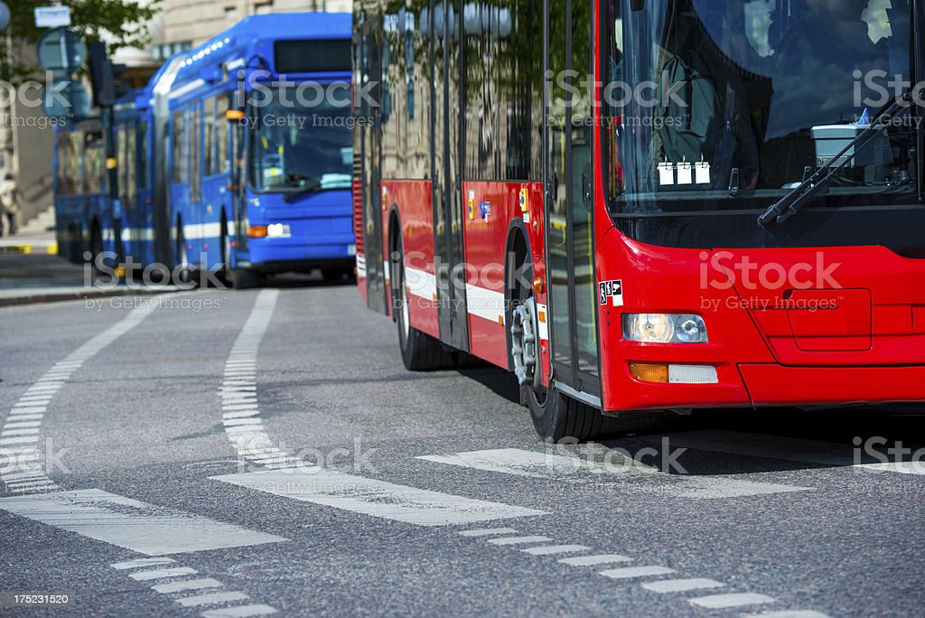Buses in traffic stock photo