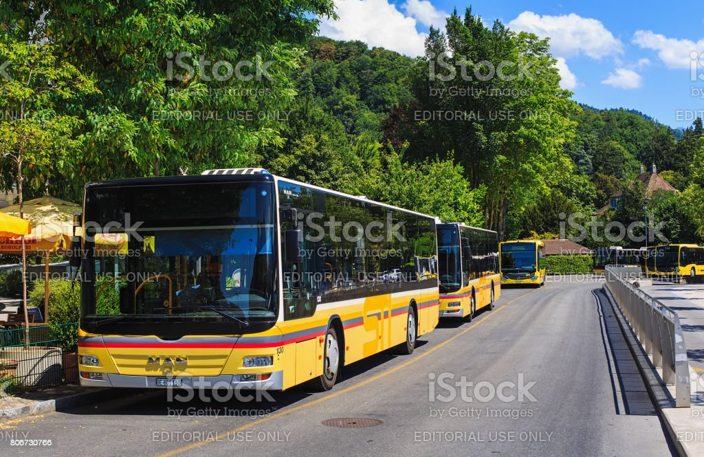 Buses parked along a street in the city of Thun, Switzerland stock photo