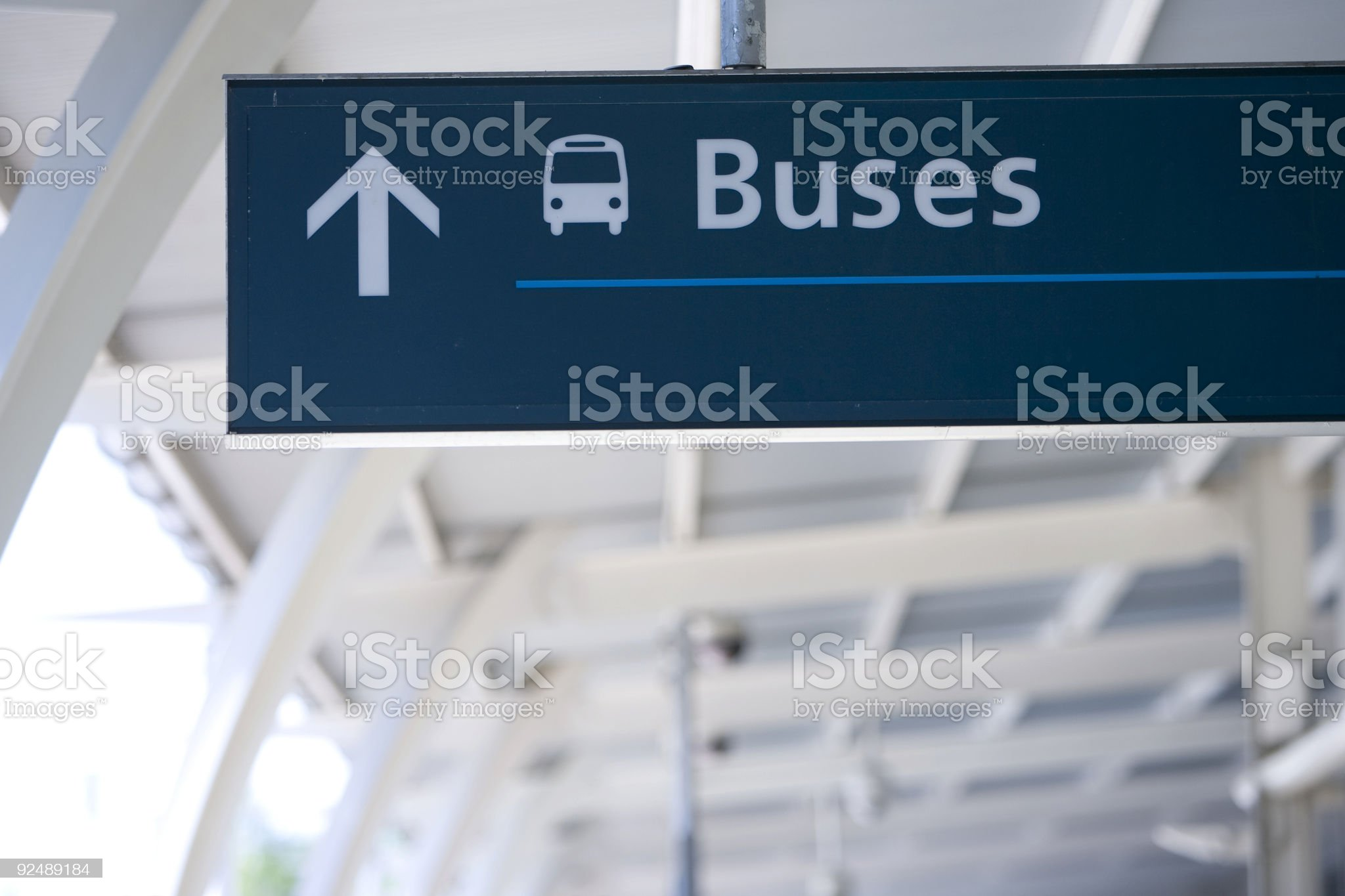 Buses sign at an airport with architecture in background royalty-free stock photo