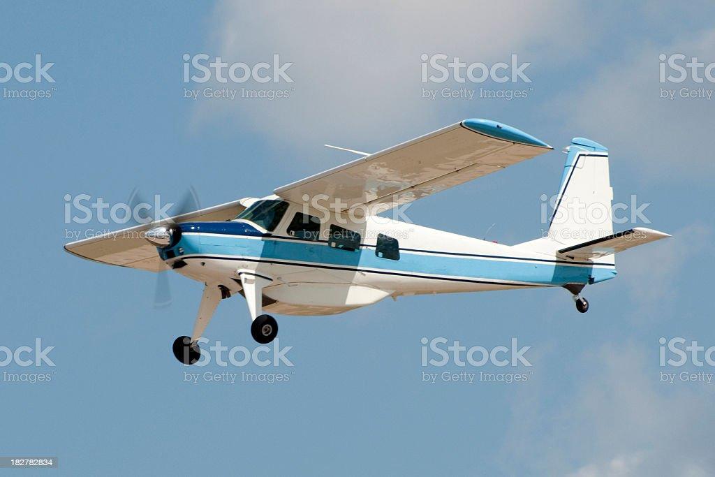 bush plane Helio H295 Courier flying stock photo