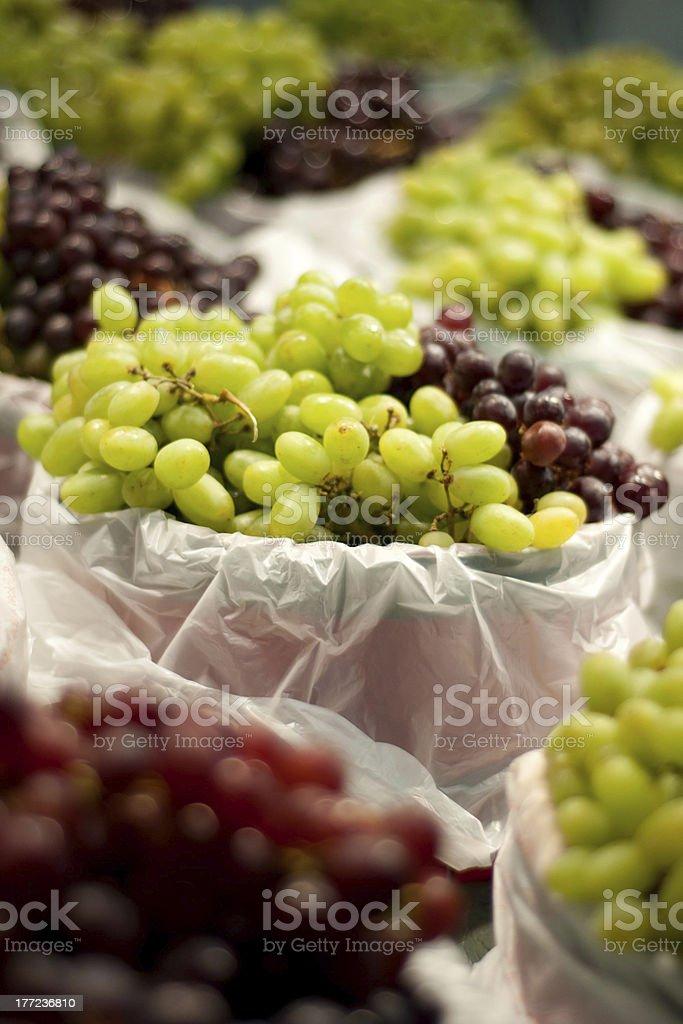 Bushels of Green and Purple Grapes stock photo