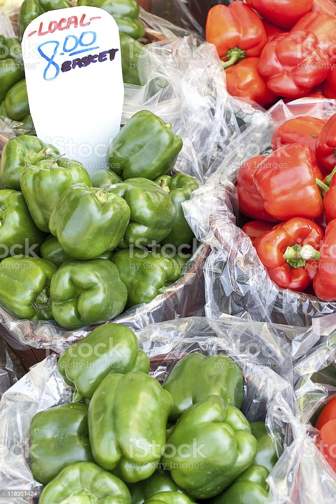 Bushels of green and red peppers stock photo