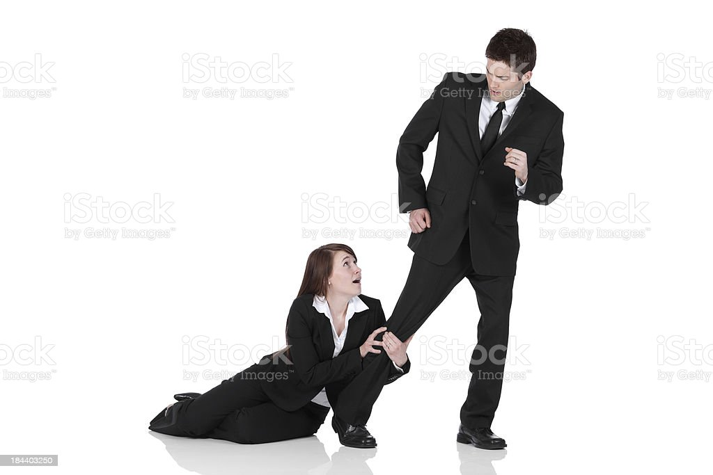 Busiesswoman holding the leg of a businessman stock photo