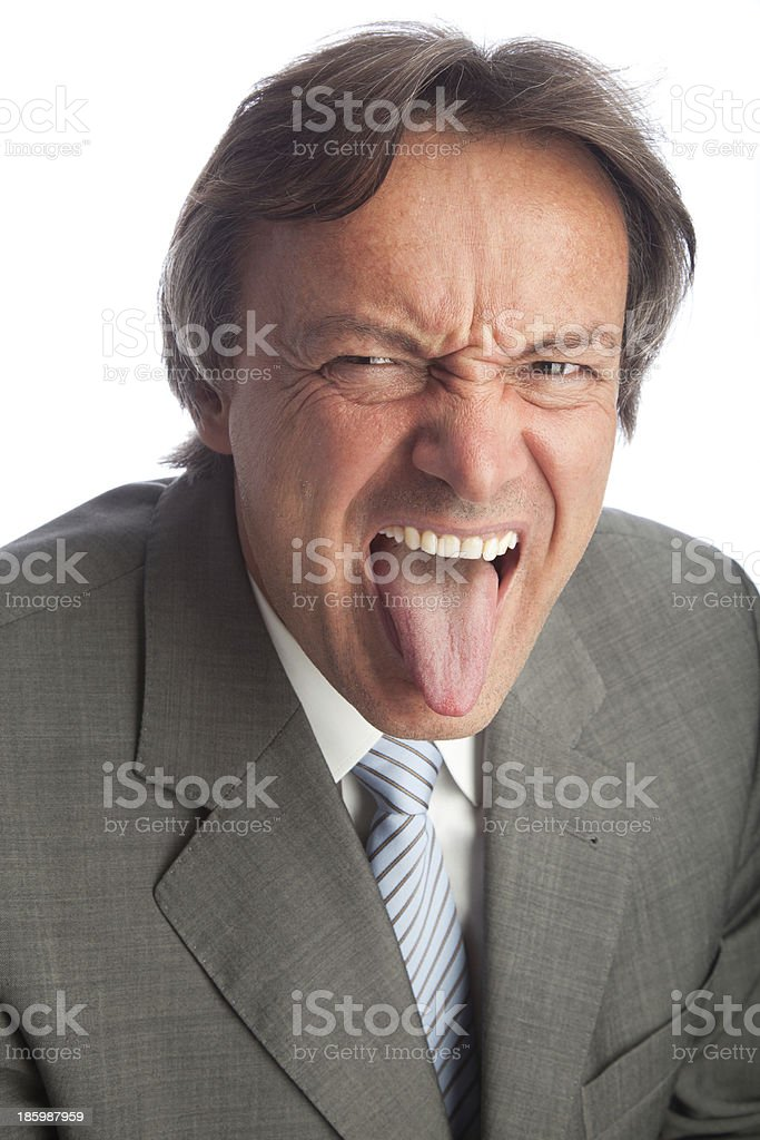 busiinesssman poking his tongue out stock photo
