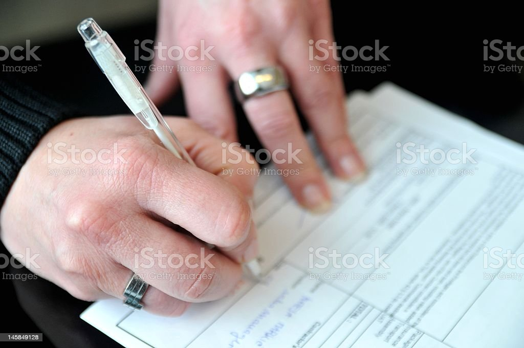 Busineess woman to fill in the form royalty-free stock photo
