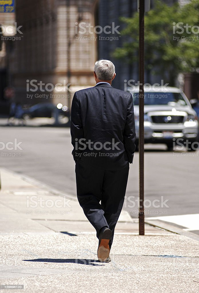 Busines man walking back to the office royalty-free stock photo