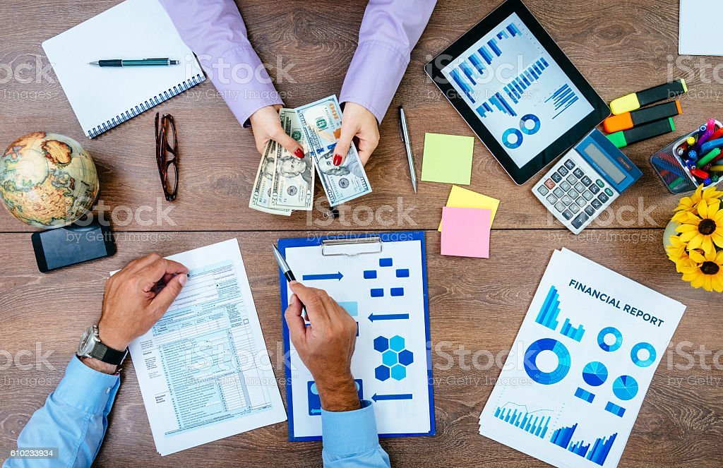 Busines person counting money for tax payment stock photo