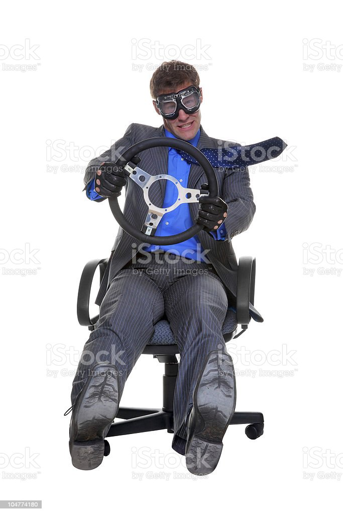 Businesman driving an office chair royalty-free stock photo