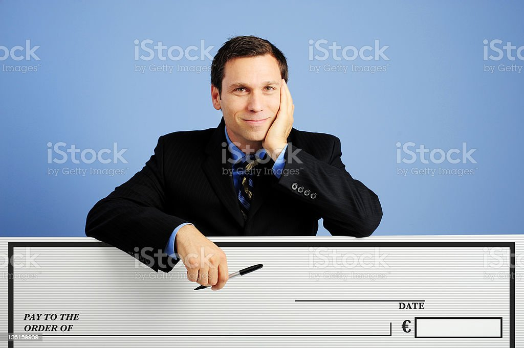 Businesman leaning on Blank Check with blue background stock photo