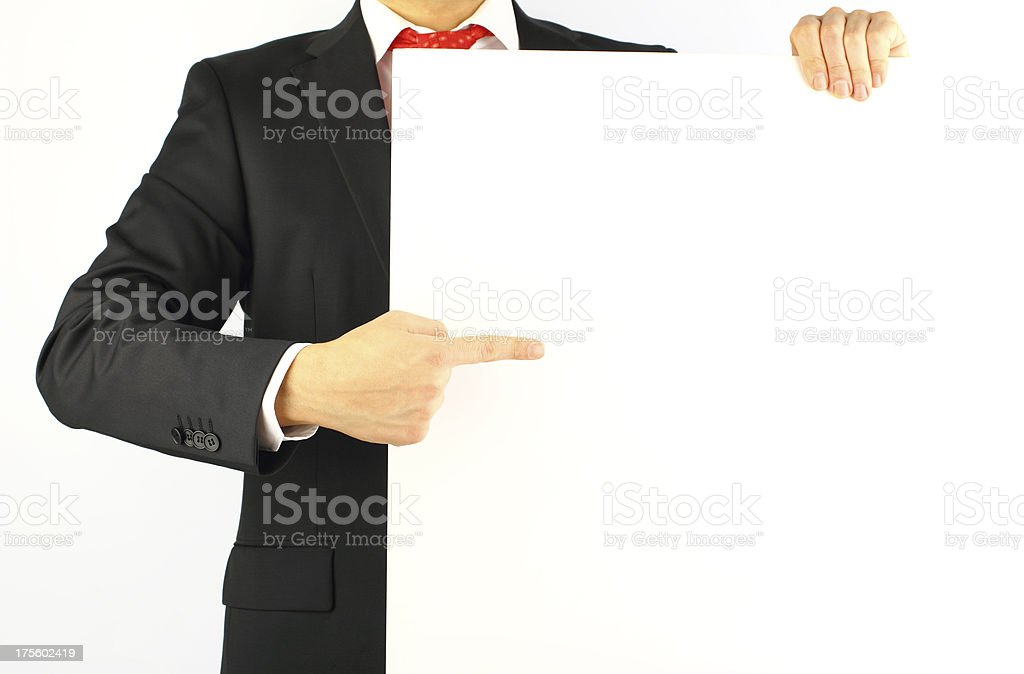 Businesman pointing to a blank sign royalty-free stock photo