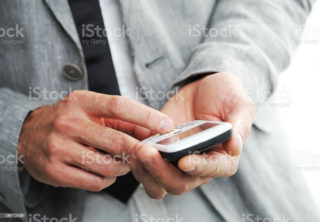 businesman avec un téléphone mobile intelligent photo libre de droits