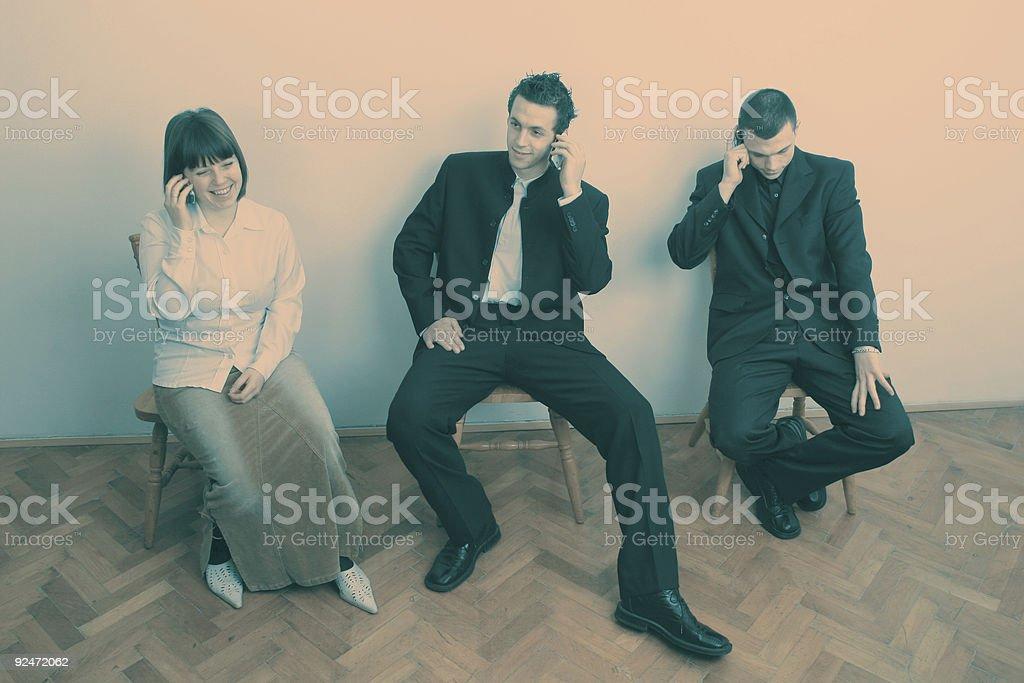 Businespeople on phones royalty-free stock photo