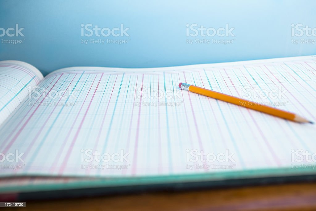 Business:  Accounting Ledger page with pencil.  Blue background stock photo