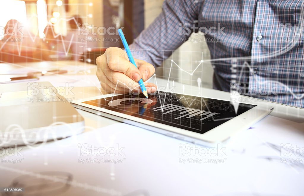 Business adviser analyzing financial figures denoting progress  of company stock photo