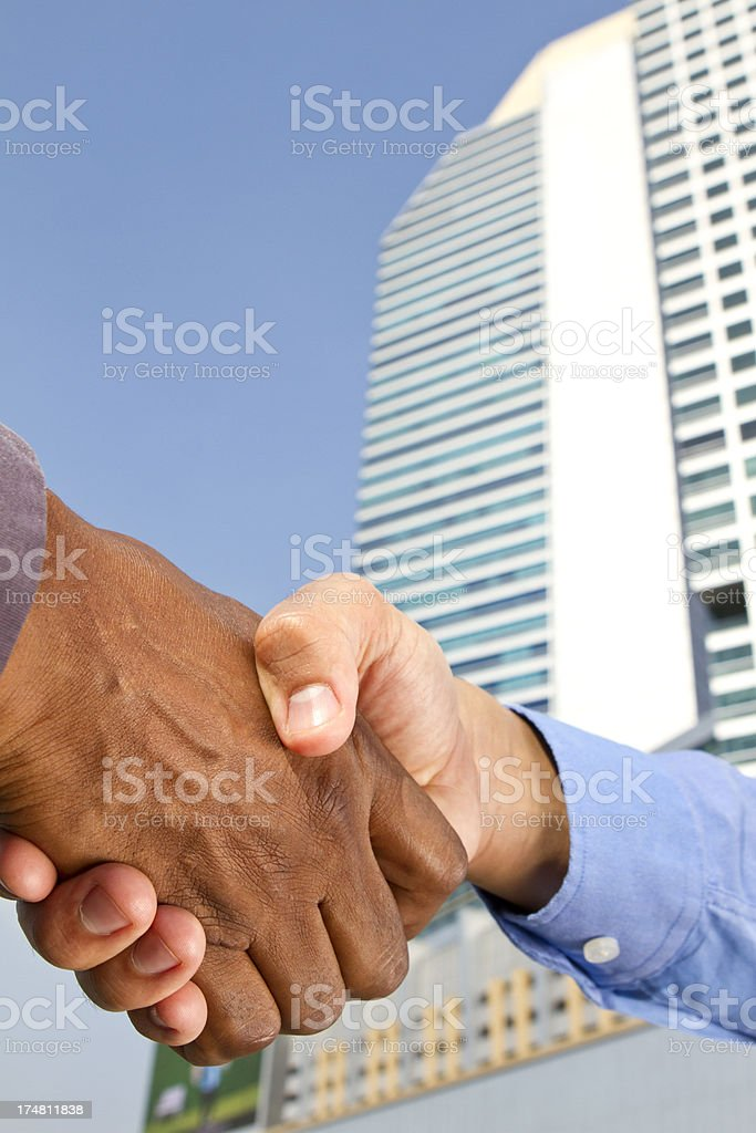 Business agreed and sealed with a handshake in financial district royalty-free stock photo