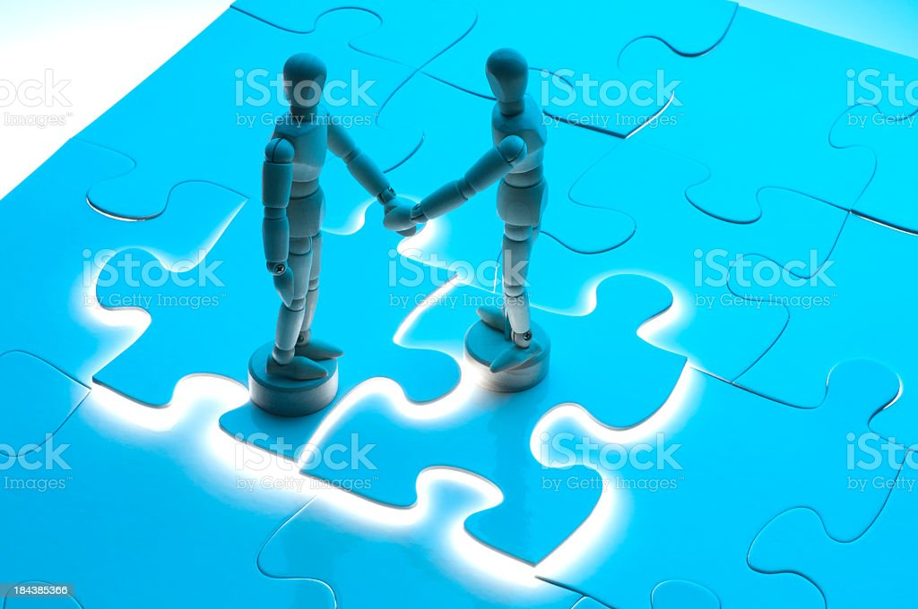 Business agreement concept with wooden figures royalty-free stock photo