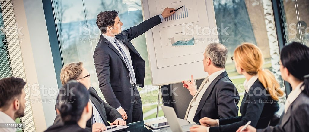 Business analyst explains his findings stock photo