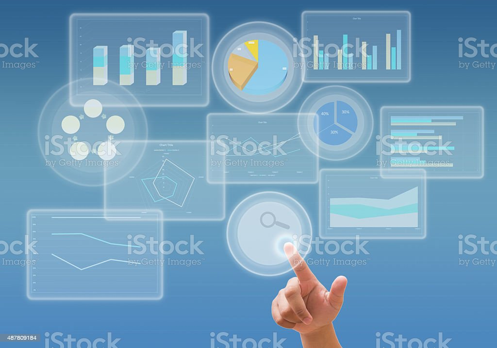 business analyze graph and working with touch screen technology stock photo