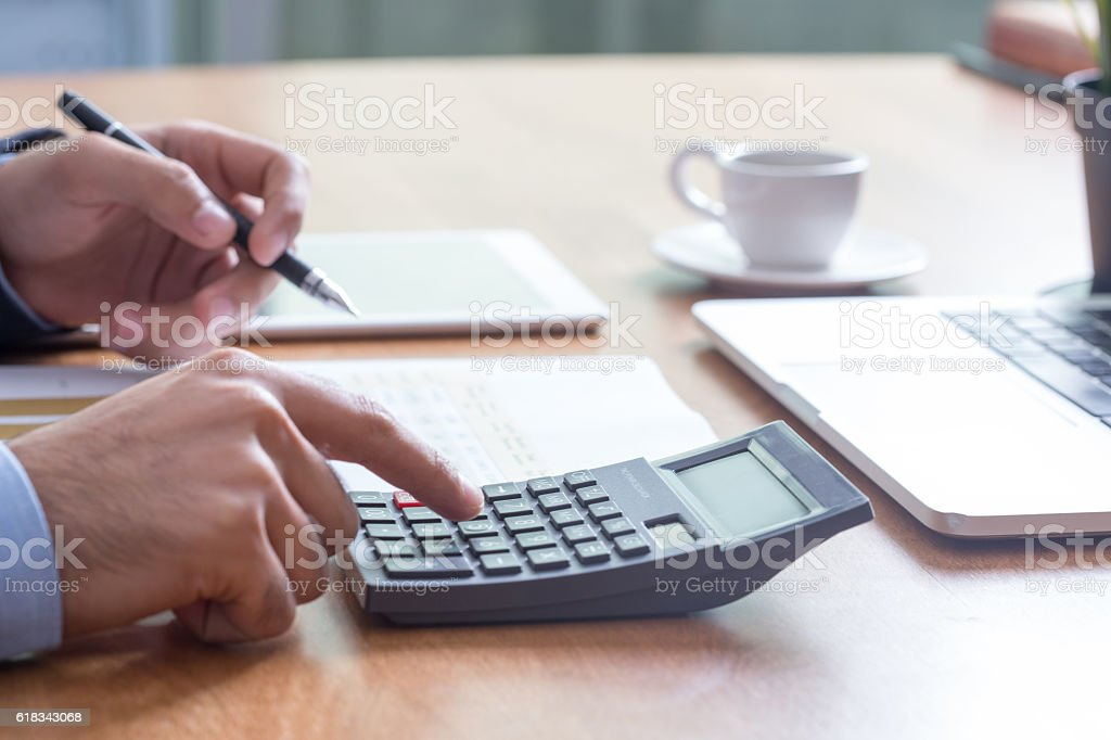 Business and Finance Concept: Businessman Analyzing Financial Charts stock photo