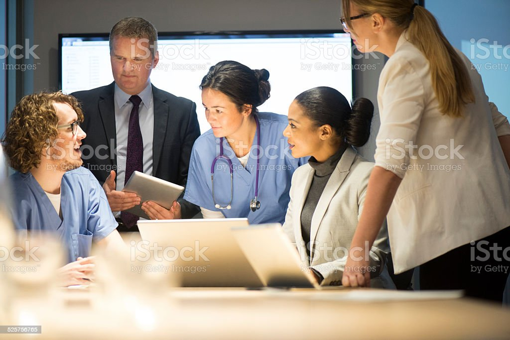 business and medicine working together stock photo