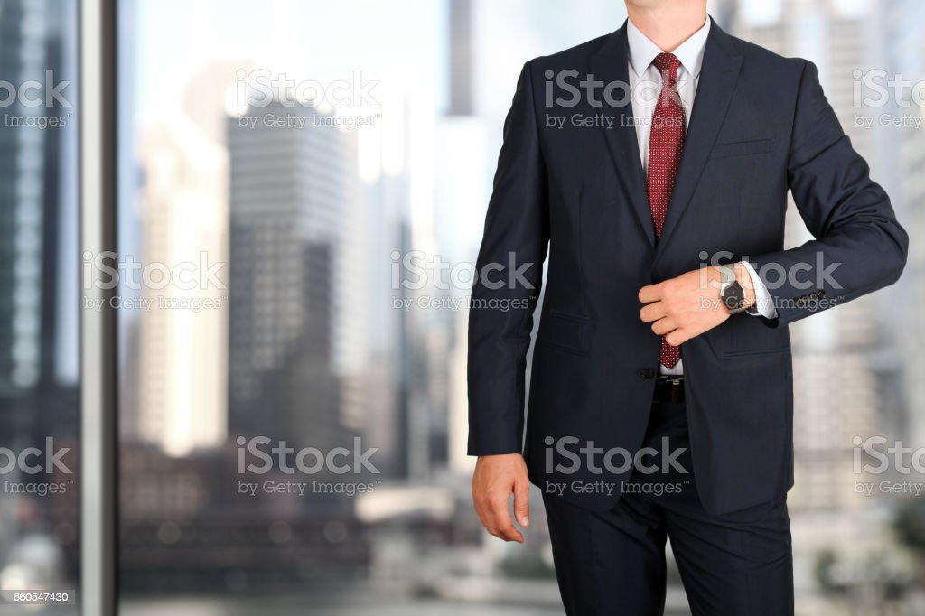 business and office concept - elegant young fashion business man in a blue/navy suit stock photo