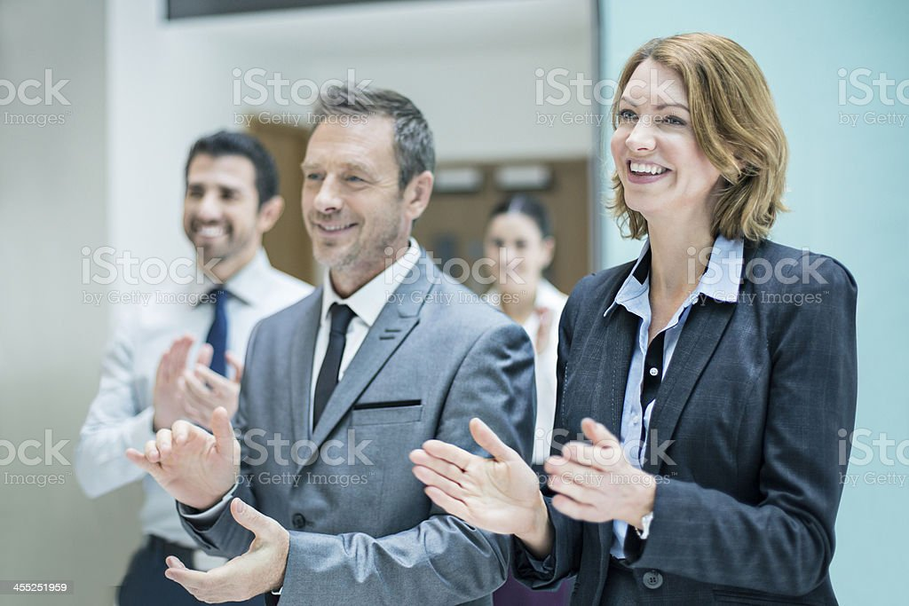 Business applauding success stock photo