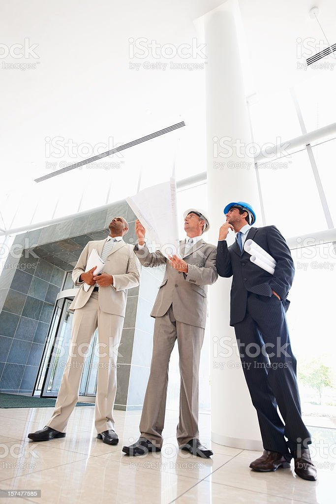 Business architects looking up royalty-free stock photo
