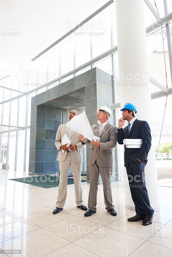 Business architects with blueprints royalty-free stock photo