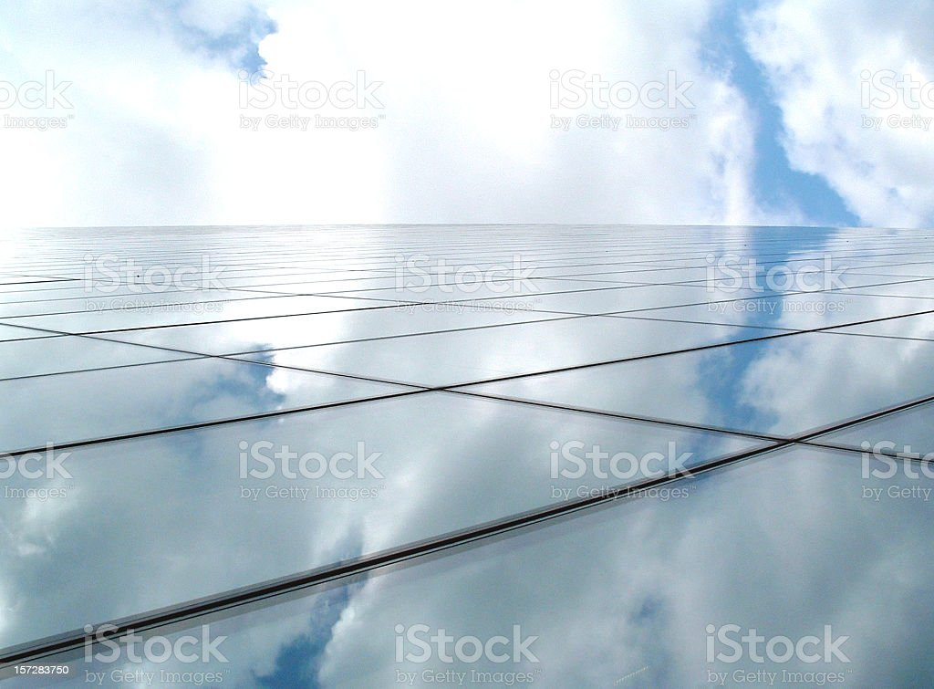 Business architecture forming a futuristic glass horizon with blue sky royalty-free stock photo