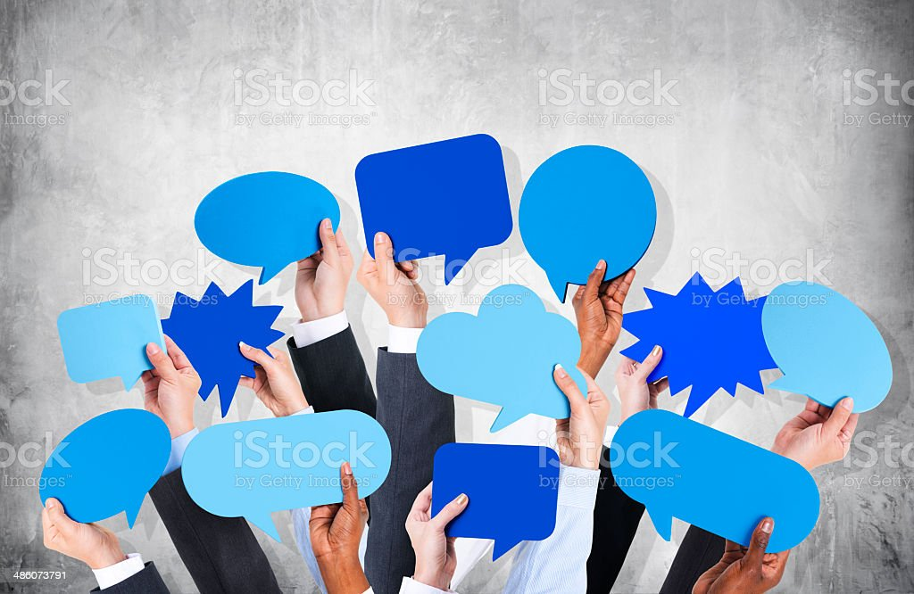 Business Arms Raised with Speech Bubble by Concrete Wall stock photo