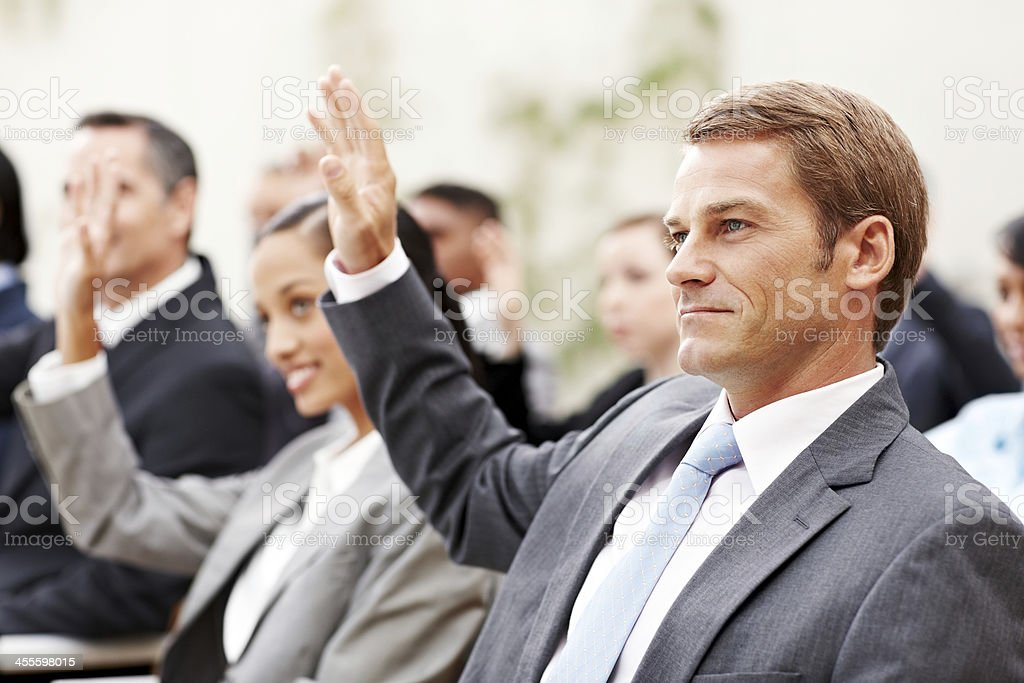 Business Audience Members Raising Their Hands royalty-free stock photo