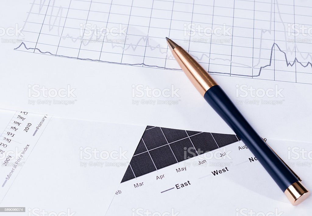 Business background with pen and financial charts stock photo