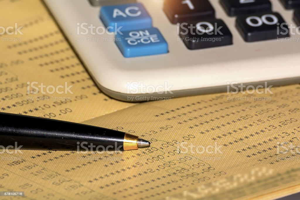 Business background,Bank account passbook with pen and calculator stock photo