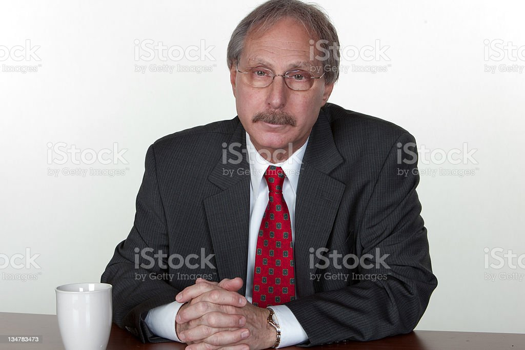 Business: bored businessman drinking coffee stock photo