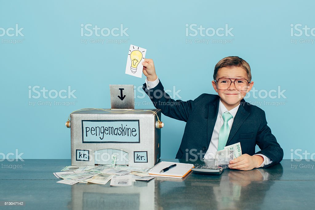 Business Boy Puts Ideas in Machine and Makes Danish Money stock photo