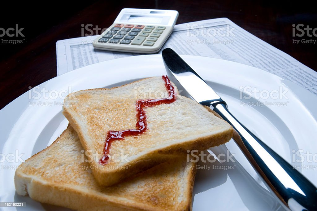 business breakfast concept with calculcator and toast royalty-free stock photo
