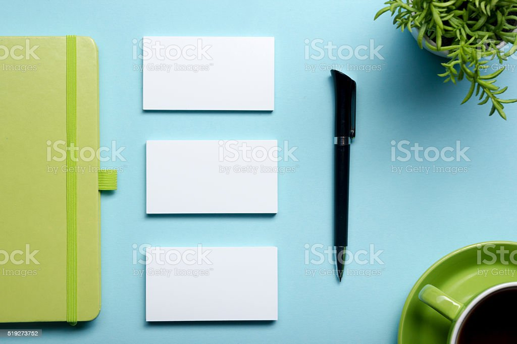 Business card blank, notepad, flower, coffee cup and pen at stock photo