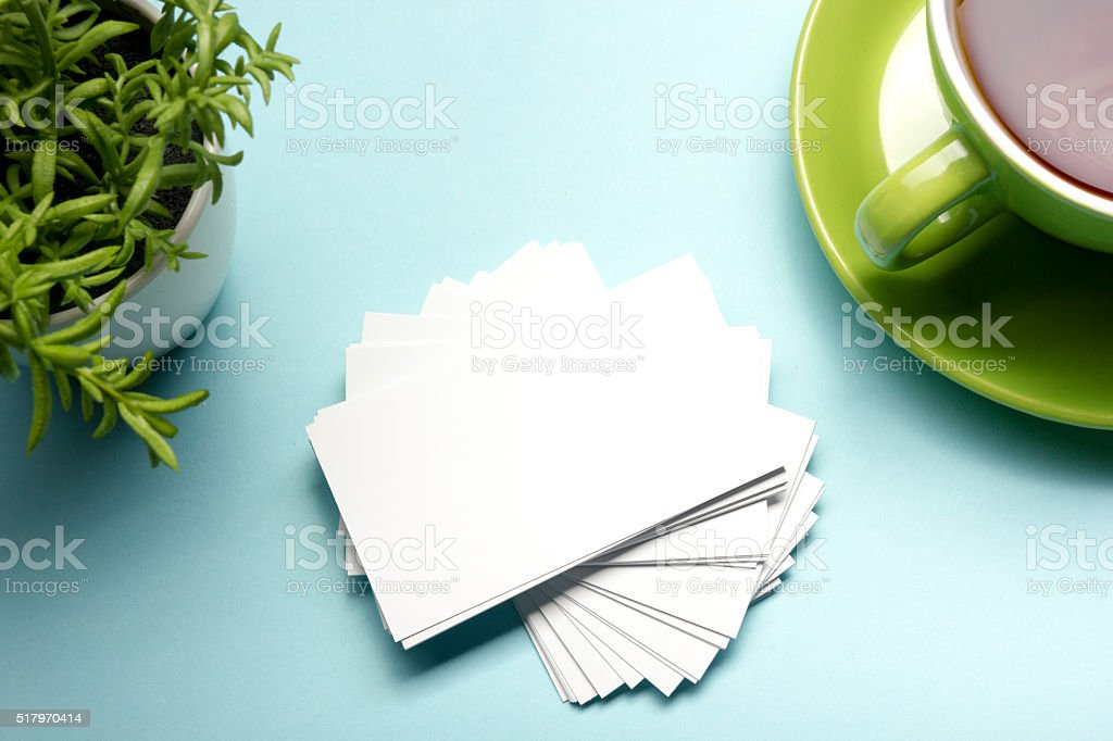 Business card blank over office table. Corporate stationery branding mock stock photo