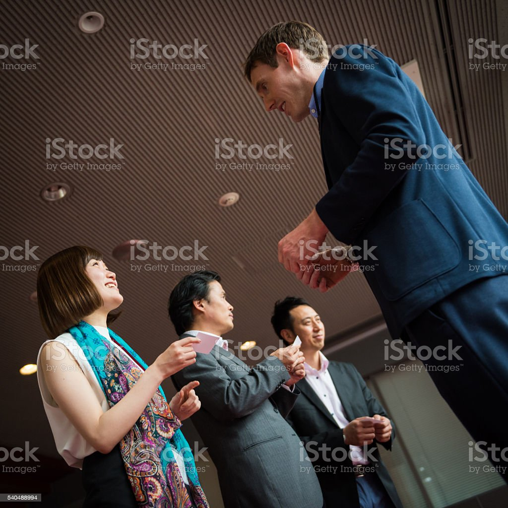 Business card exchange at a conference stock photo