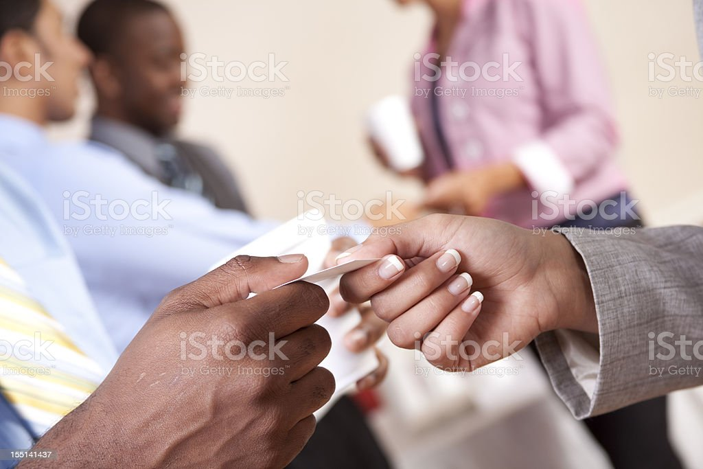 Business card exchange. People. Hands. Multi-ethnic group. Professionals. stock photo