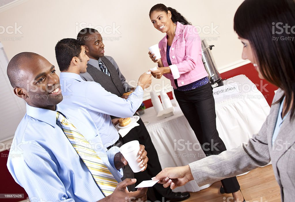 Business card exchange social event. Multi-ethnic group. Professionals. stock photo