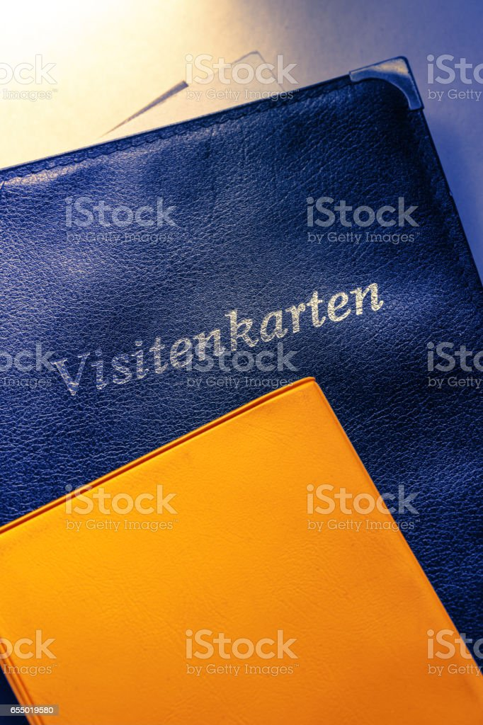 Business card holder and other notebooks stock photo